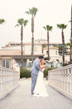 Kisses on the boat dock #lovinglifebythebay #sandiegoweddings  | Photo by Alon David Photography