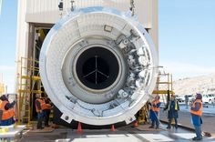 Engineers at Orbital ATK in Promontory, Utah, prepare to test the five-segment booster that will help power NASA's Space Launch System to begin missions to deep space.