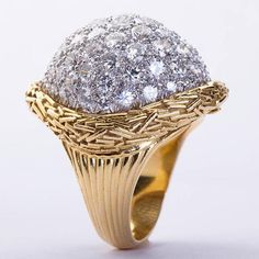 A fine diamond pavé dome ring set in 18 karat stylized yellow gold. Ring size 6 (complimentary re-sizing) No. 4394