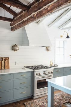 Log cabins 327144360432751066 - light blue kitchen cabinets, white shiplap walls, white oven range, wood ceiling beams Source by meganclairephoto Block House, Log Cabin Kitchens, Tuscan Kitchens, Luxury Kitchens, Rustic Kitchens, Cottage Kitchens, Light Blue Kitchens, White Cabin, White Shiplap Wall