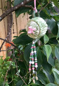 Cute garden inspired repurposed mobile and sun catcher with cute cabbage shaped tea pot and beads!