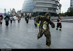 London, UK. 21st September 2013. Hundreds of people dressed as gorillas run, jogged or walked 7km though the City of London in the 10th annual Great Gorilla Run to raise money for The Gorilla Organization. Picture by Julie Edwards/Alamy Live News