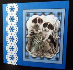 Cute little vintage puppies on blue backing on Craftsuprint designed by Bodil Lundahl - made by Ulla Skraedderdal - First I prited the sheet on a good quality of paper, and cut all parts out. Layered with 3D pads, and decorted with an border and half pearls. Just love those dogs, and sheets too. - Now available for download!