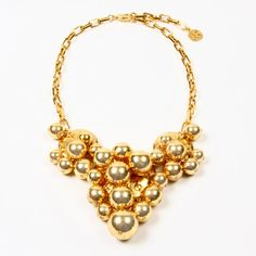 Ben-Amun launches the Gold Ball Collection inspired by Jackie O's gold bell cuff worn at the John Kennedy Profile in Courage Award Charity Gala in 1989. #jewelry #jackieo #vogue