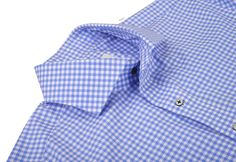 Sic-Tess Soft Light Blue Gingham Casual shirt in gingham checks for the summer wardrobe.  Features: Roma cutaway collar with 2-Button Mitered, maroon red thread for stitching buttons and button holes.