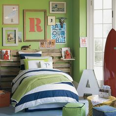 """Joshua's green room #6 Yes: loves the green in this scheme, orange and navy, loves the initial letters (painted initial and marquee), and very text-oriented wall elements.  But """"I hate, hate, hate that door color (bright white)."""""""