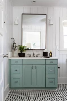 Blue Green Bath Vanity with Black Mirror color is vanity is pretty along with black/white scheme