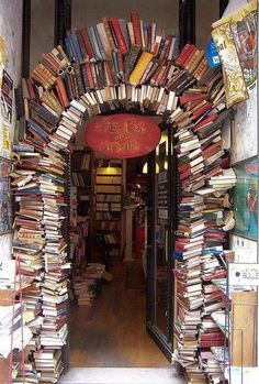 Archway of repurposed books in library, retail store display or home decor; portal to knowledge; Upcycle, Recycle, Salvage, diy, repurpose! For vintage cottage flea thrift ideas and goods shop at Estate ReSale ReDesign, Bonita Springs, FL