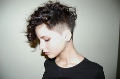 Shaved sides, long curly top hair