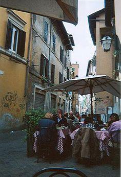 Side street sidewalk cafe. Rome. ITALY.