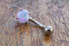 "Synthetic purple fire opal belly button jewelry ring. The 8mm purple opal is prong set and glows in the light with radiant iridescence. The opal belly ring is 14 gauge and 3/8"" long (10mm), and is mad"