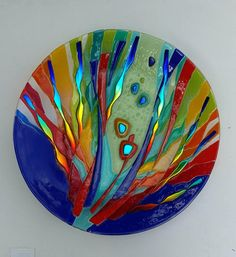 This platter is 19.25 inches across. Is a one of a kind design, and has hanging hooks on the back so wall display is possible.