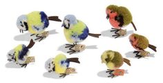 SEVEN POM-POM BIRDS: four Blue Tits, (two 6504,4 and two 6508,4), FF buttons and cream paper tags, 1934-43 --1½in. (4cm.) and 2in, (5cm.) high; Golden Bunting, (6504,12), FF button and red cloth tag, 1934-36 --1½in. (4cm.) high; and two Robins, (6508,1 and 6504,1), FF buttons and cream paper tags, 1934-43 --2¼in. (5.5cm.) and 1½in. (4cm.) high (one tag torn) | Private Collections & Country House Sales Auction | 20th Century, All other categories of objects | Christie's