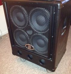 Amp with visible speakers, metal grate cover.