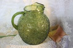 VIntage Large Green Glass Pebble Water Pitcher. Starting at $30