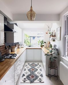 White units and wooden worktops in the kitchen with berber style rug and statement lighting Kitchen Room Design, Dining Room Design, Home Decor Kitchen, Interior Design Kitchen, New Kitchen, Home Kitchens, Kitchen Dining, Kitchen Taps, Small Dining