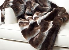 I already have a faux fur throw, but I like this one so much more! Z Gallerie - Zambia Throw in Chocolate