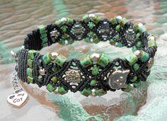 Micro Macrame Bracelet with Toho Cubes Hybrid Turquoise  & Jet Black Beads with Kitty Cat Face Focal Beads. $32.00, via Etsy.