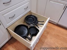 skillets and cast iron under the cooktop