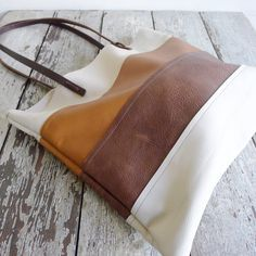 this image is of the caramel color palate mix of leathers. visit site to see images of design done in veg tan leather one in stock no closure. Diy Leather Gifts, Leather Crafts, Handmade Leather, Leather Purses, Leather Handbags, Leather Totes, Leather Bags, Leather Backpacks, Shoping Bag