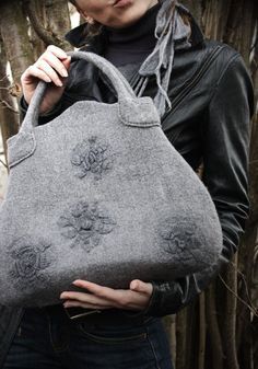 This handbag can be made by custom orderOnly Wet felted from merino wool with hand woven flower decor. Natural grey color, subtle form, romantic but not too sweet floral decor, elegant texture make this bag a sublime accessory that goes so well with many styles and reveals your feminine side