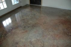 Cement floor.  Lightly sand cement, wash thoroughly.  Dilute oil based paint   *small Rustoleum with paint thinner.  1 paint/4-5 parts thinner.  Wet floor w/water, small areas.  Pour small amounts in random patterns.  Lightly swirl colors.  Don't overdo.  Continue until floor is done.  Let dry.  This floor: dark brown, sand, gray.  2nd coat: rust, metallics and original color.  Can add more coats.  Let dry between.  Polyurethane.  Paint will be dull until poly is added.