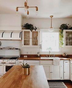 beautiful white kitchen with butcher block countertops #brightkitchenlighting