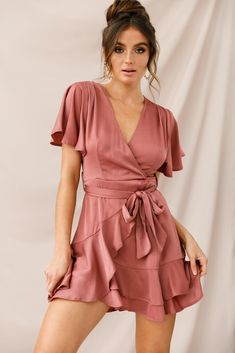 """Hey pretty lady, you're causing quite the commotion in our sweet, sexy and silky Cami dress! Featuring a faux wrap skirt that ties at the waist, an on-trend ruffle hemline and fluttery angel sleeves. Team it with delicate gold jewelry and nude heels and sashay your way across the dance floor, right in front of that hottie who's been staring at you all night (a.k.a. your future ex-boyfriend). MODEL INFOModel is wearing size XSHeight: 5'8""""Bust: 34""""Waist: 23""""Hips: 34""""Size GuideCAREHand Summer Outfits, Casual Outfits, Cute Outfits, Fashion Outfits, Womens Fashion, Summer Clothes, Ladies Fashion, Wrap Dress Short, Faux Wrap Dress"""