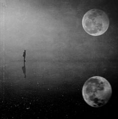 black white photography man standing looking up a full moon   February 2015
