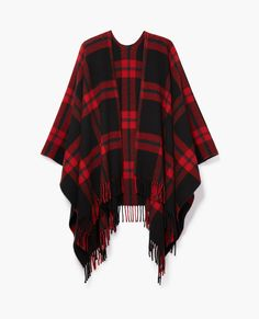 Get two trends in one with a plaid Kooples Checked Wool Poncho. The classic checked wool pattern makes it an ideal layering piece.