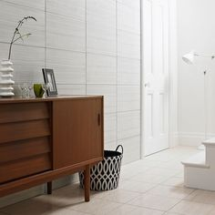 This large format tile comes in and is suitable for walls. Add movement to your walls using this beautiful linear design tile. HD Serpentine grey gloss would create a contemporary look Cheap Bathroom Tiles, Cheap Bathrooms, Large Bathrooms, Bathroom Wall, Grey Wall Tiles, White Tiles, Large Format Tile, Light Grey Walls, Minimalist Bathroom