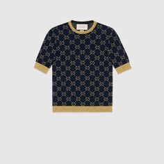 Shop the GG cotton lurex top by Gucci. Gucci continues to explore incorporating original design elements into new collections. The emblematic monogram motif from the 1970s is reinterpreted in gold lurex contrasted by a dark blue.
