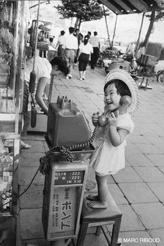 +~+~ Vintage Photograph ~+~+   Japanese girl having great fun pretending to talk on the phone.  Japan 1958.