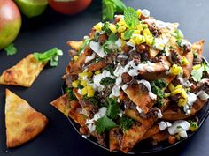 Forget everything you thought you knew about nachos and open your mind (and your mouth) to this Indian-inspired version. Crispy naan flatbread pieces serve as a sturdy and delicious stand-in for the standard tortilla chip base, and they're loaded up with generously spiced toppings that are at least as flavorful (if not more!) than their traditionally Tex-Mex counterparts.