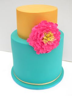 Two tier lemon butter cake matt gold, teal and hot pink Confirmation cake. Open ruffle peony made 100% from flower paste.