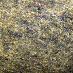POCONO GREEN. Blotches of olive green with patterns of black and gold flakes. Exquisite granite color available at Knoxville's Stone Interiors. Showroom located at 3900 Middlebrook Pike, Knoxville, TN. www.knoxstoneinteriors.com. FREE Estimates available, call 865-971-5800..