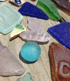 half round marble from an antique bottle along with assorted antique beach glass pieces