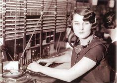 A long-distance operator at her switchboard in 1930.