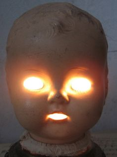 Angry demon doll head