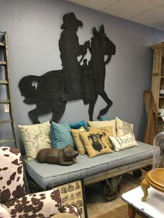 Folk Art Bronc Rider Decorates A Wall In The New Store.