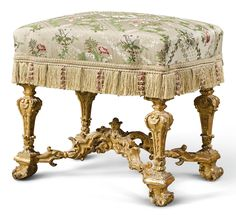 A Louis XIV carved giltwood tabouret, circa 1690 the shaped rectangular padded seat above tapering square legs carved with acanthus and foliage joined by a scrolled stretcher, on scrolled and foliate feet