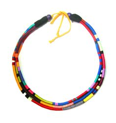 Tribal Style Multi Strand Thread Wrap Rope African Necklace. The necklace comprises three color blocked layers which are made from cotton thread. It
