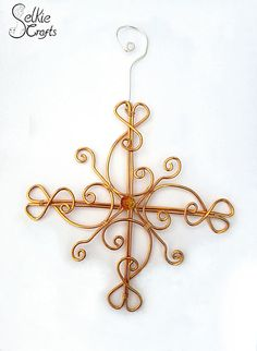Gold snowflake star Christmas decoration £21.00