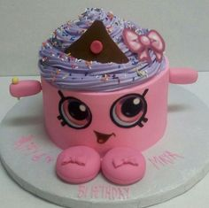 Shopkins Round Cake with buttercream icing, edible images and fondant accents.
