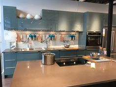 Image result for high gloss white and turquoise kitchen