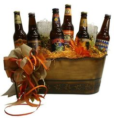Every Season, the best breweries produce beers with tastes to match the season. We pick the most popular seasonal beers to include in this gift basket. Includes 6 different seasonal craft beers with two glass beer mugs in a metal embossed party pail. Fundraiser Baskets, Raffle Baskets, Fall Gift Baskets, Beer Basket, Craft Beer Gifts, Pumpkin Beer, Boyfriend Gift Basket, Glass Beer Mugs, Fall Gifts