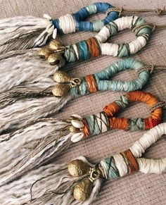 I've been making these prosperity charms. Some have handmade Indian brass bells (see picture) and tiny cowrie shells that I've had in my… Weaving Projects, Weaving Art, Yarn Crafts, Sewing Crafts, How To Make Tassels, Diy Tassel, Textile Fiber Art, Macrame Plant Hangers, Macrame Design