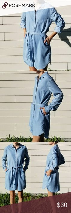 Victoria's Secret Shirt Dress Victoria's Secret shirt dress. Size 14. Light blue denim look. Light gold stitching. Button down front. Left breast pocket. Belted. Pockets. Long sleeved with buttons to roll back to 3/4 sleeve. 63% lyocell. 37% polyester. Victoria's Secret Dresses Long Sleeve