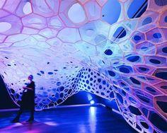 jenny sabin installs light-absorbing knitted textile pavilion at cooper hewitt
