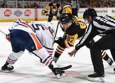 NOVEMBER 8: Sidney Crosby #87 of the Pittsburgh Penguins takes a face-off against Mark Letestu #5
